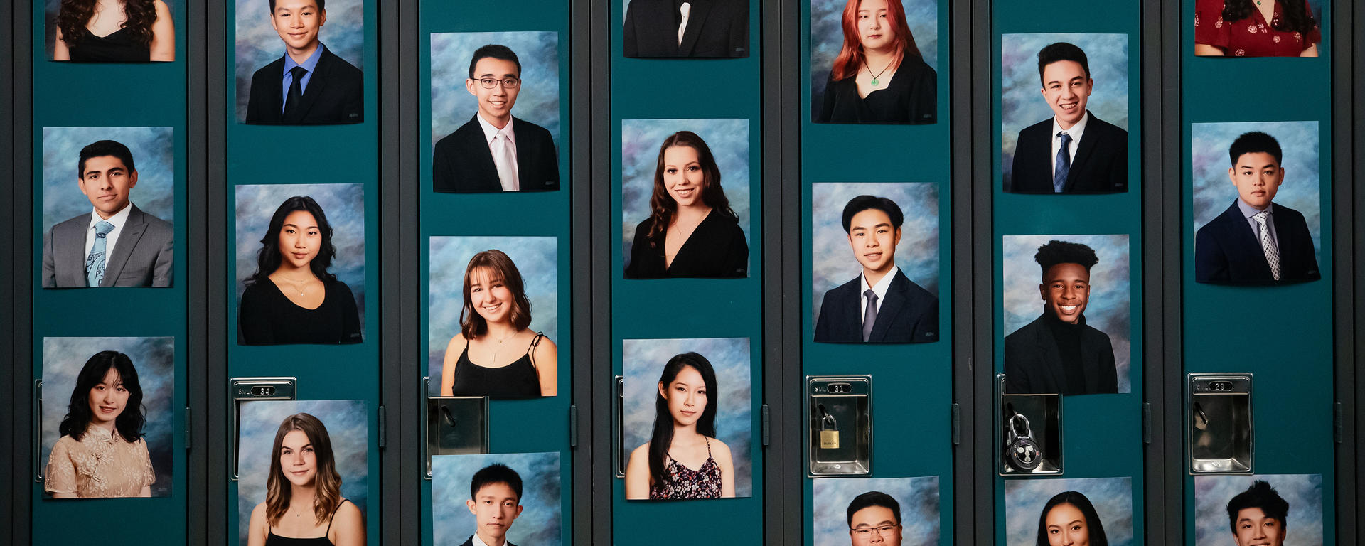 Photos of graduating students are seen on lockers during a graduation ceremony.
