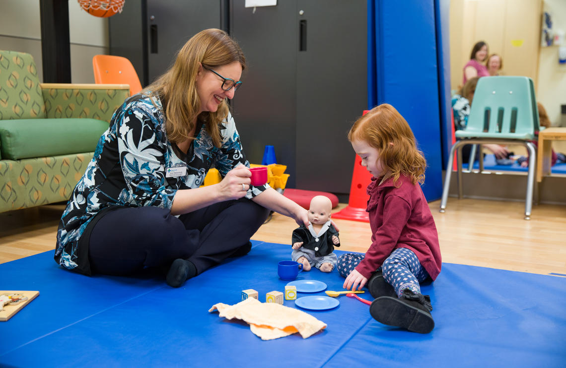 Psychologist Sue Makarchuk with Alberta Health Services interacts with Anna Strachan, 2, who needed a dose of caffeine as a preemie to help her breathe. Photos by Riley Brandt, University of Calgary