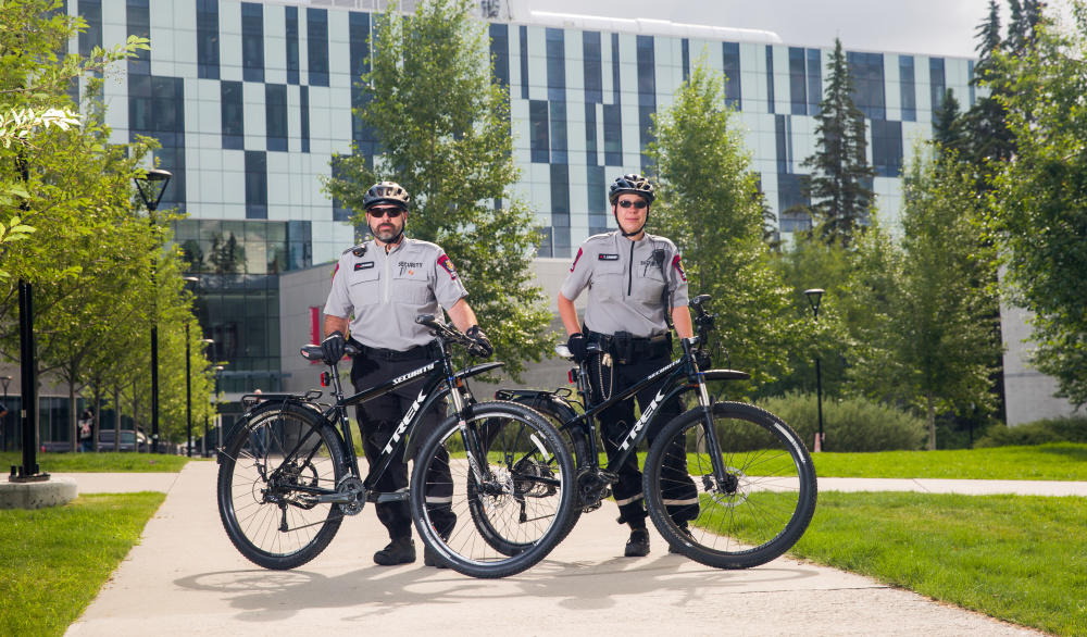 Campus Security's Jean Beaudoin, left, and Tesha Lingren are the first non-police officers to be certified Law Enforcement Bicycle Association instructors, which has major benefits for the University of Calgary.