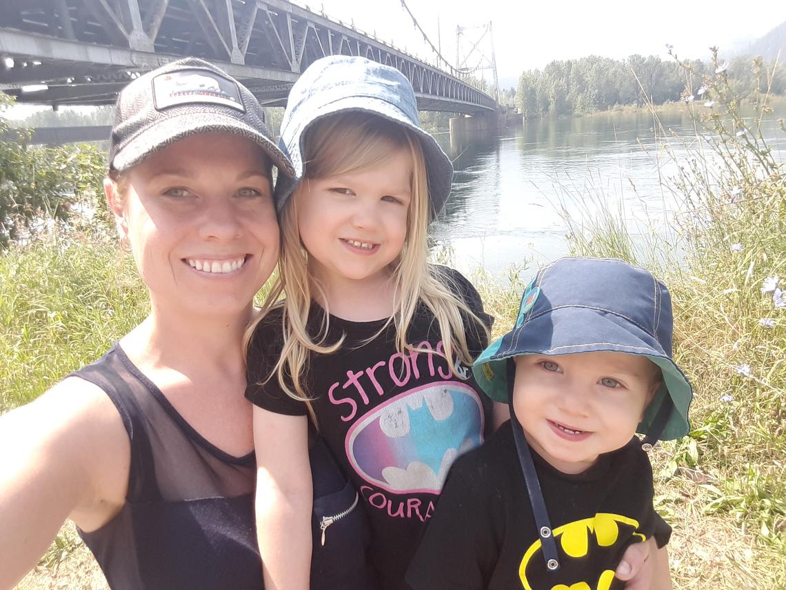 Lana Clyde plays with her two children during a park outing. The Calgary mother experienced postpartum depression a year ago and urges all moms with similar experiences to avoid feeling shame and not to be afraid to seek help.