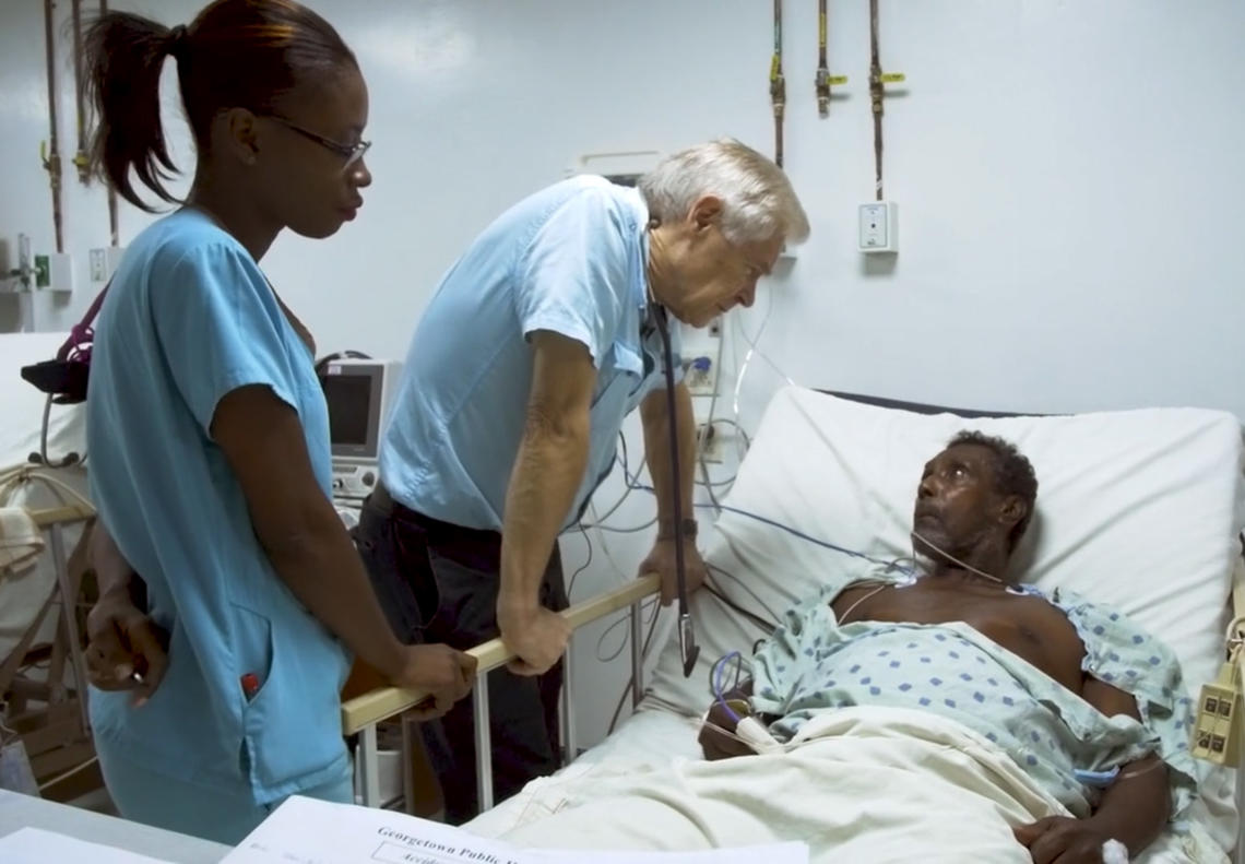Dr. Wayne Warnica speaks to a Guyanese patient.