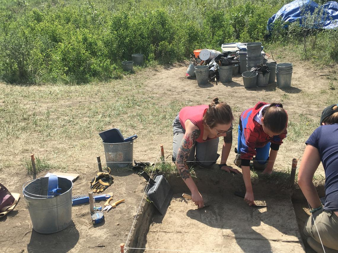 High school students hard at work at the archaeological excavation.