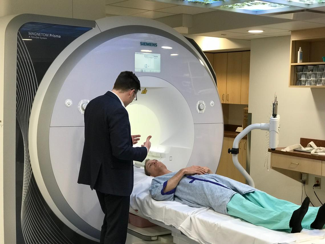 James White, director of the Stephenson Advanced Cardiac Imaging Centre, speaks to Dave Proctor as he prepares for an examination in the cardiac MRI.