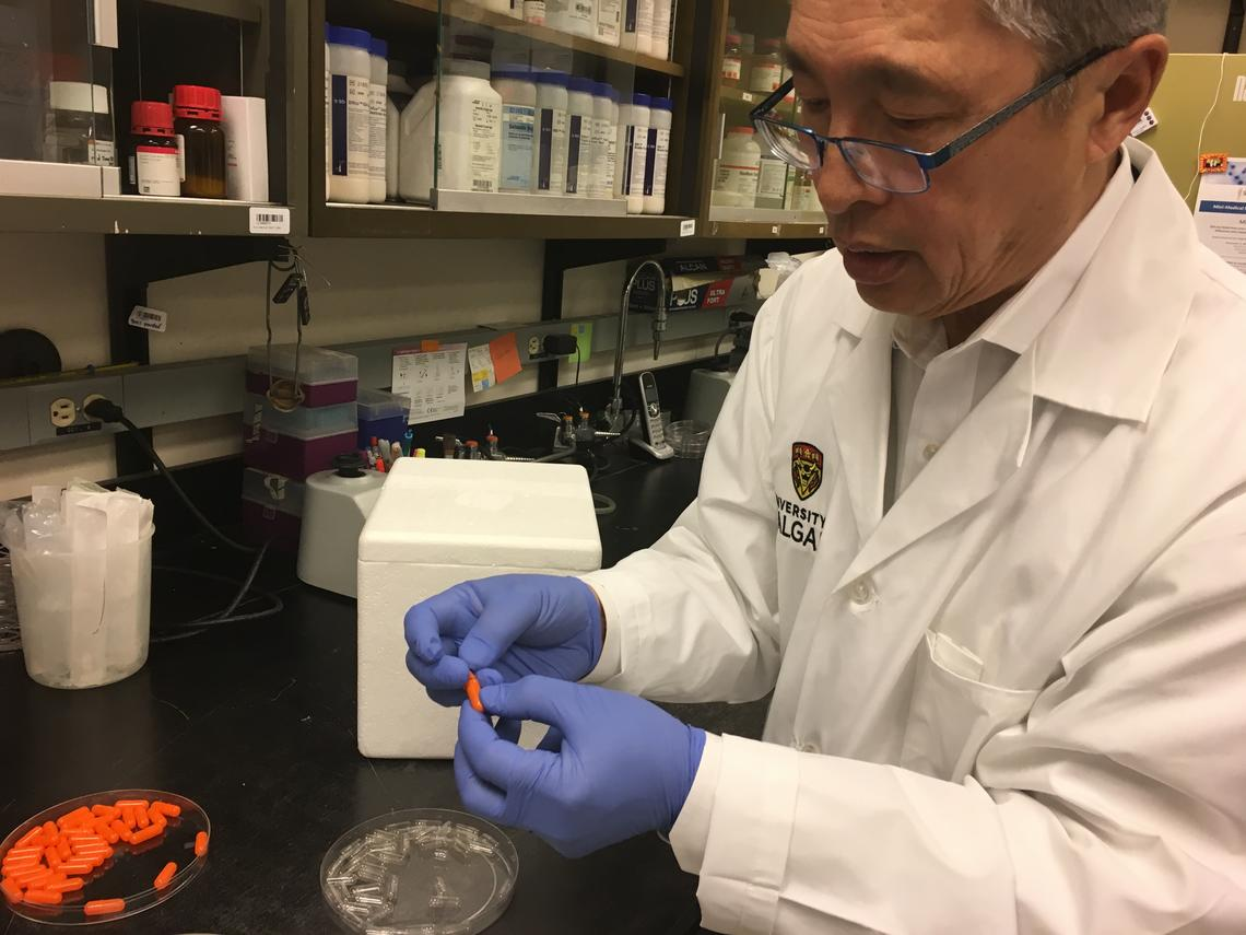 Thomas Louie with fecal capsule pills, which offer a less invasive way to treat C. difficile infections.