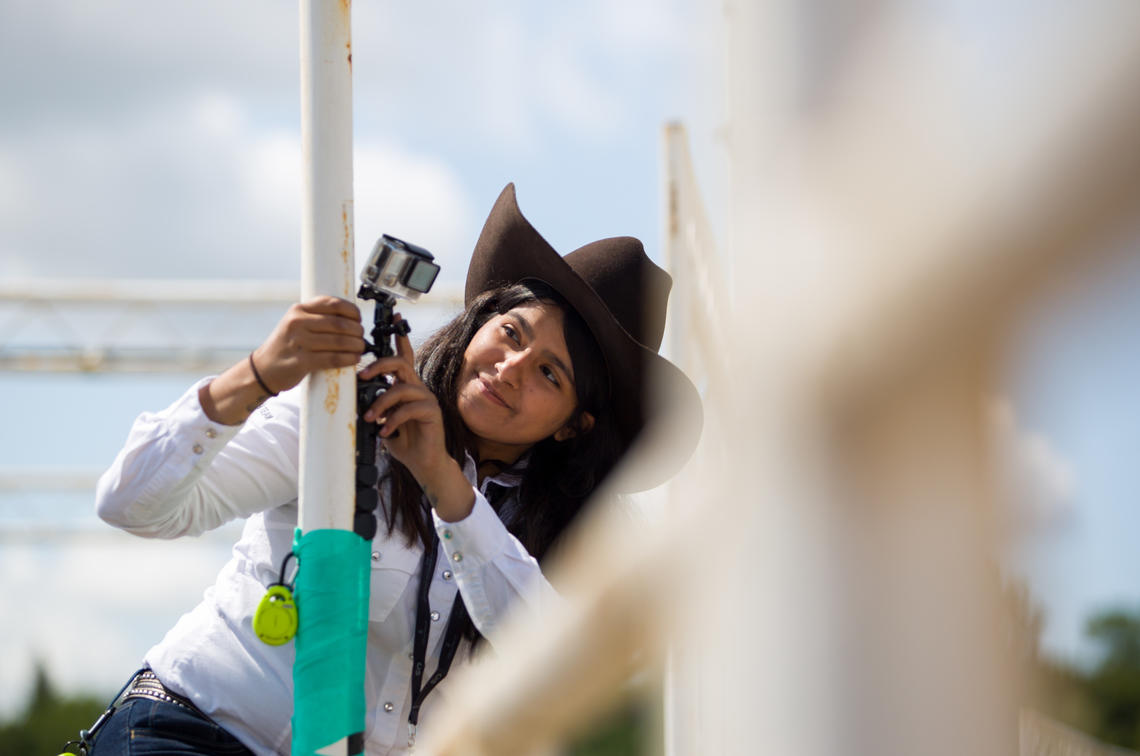 Second-year vet med student Zeanna Janmohamed adjusts a camera set up to monitor the bulls.