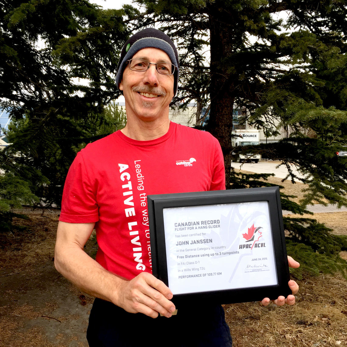John Janssen shows his official Canadian Record certificate.