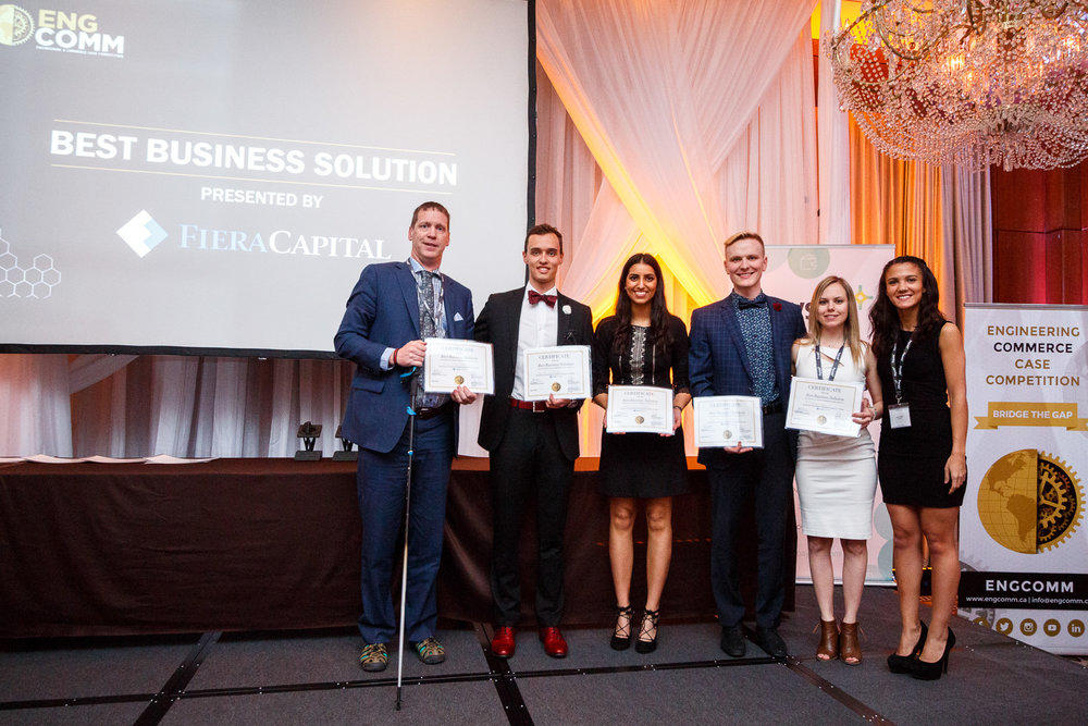 At the Engineering and Commerce Case Competition (ENGCOMM) winning first overall, best business solution and best engineering solution, from left: Cam Welsh, Haskayne senior instructor and case competition coach, NIk Golob, Manpreet Deol, Coleton Strand, Megan Leslie and Sarah Chabli, president of the ENGCOMM 2018 executive.