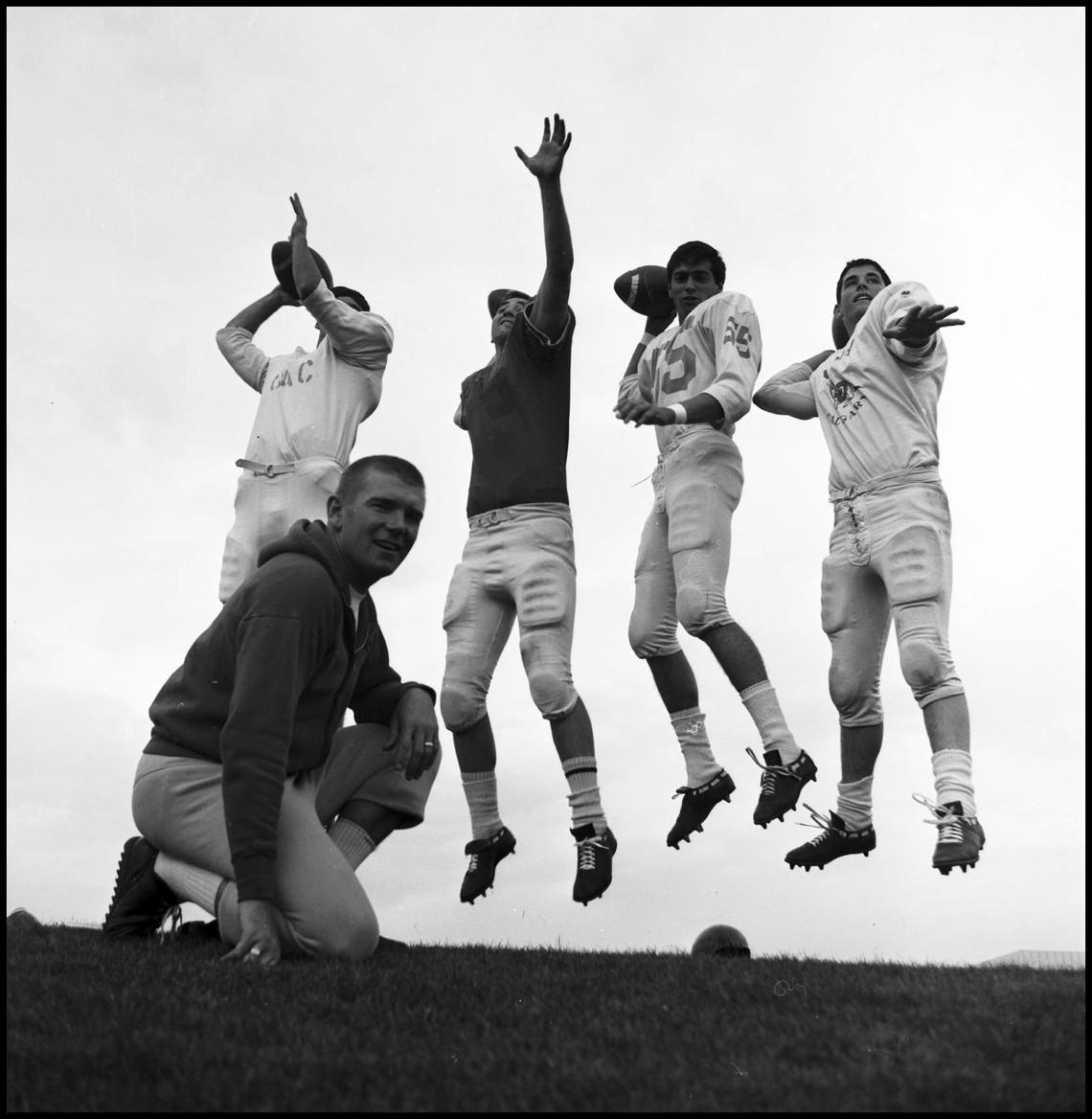 Coach Kadatz evaluates four players for the quarterback role in the 1960s.
