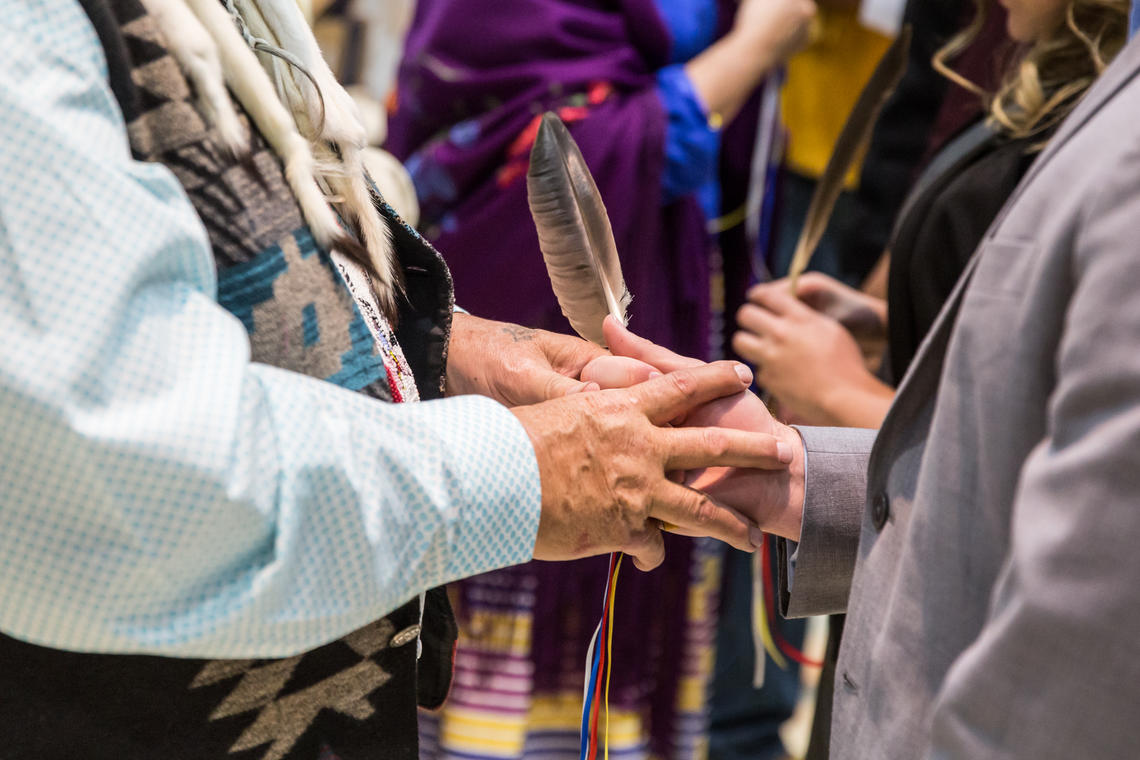 Eagle feather gifting in the Indigenous graduation ceremony