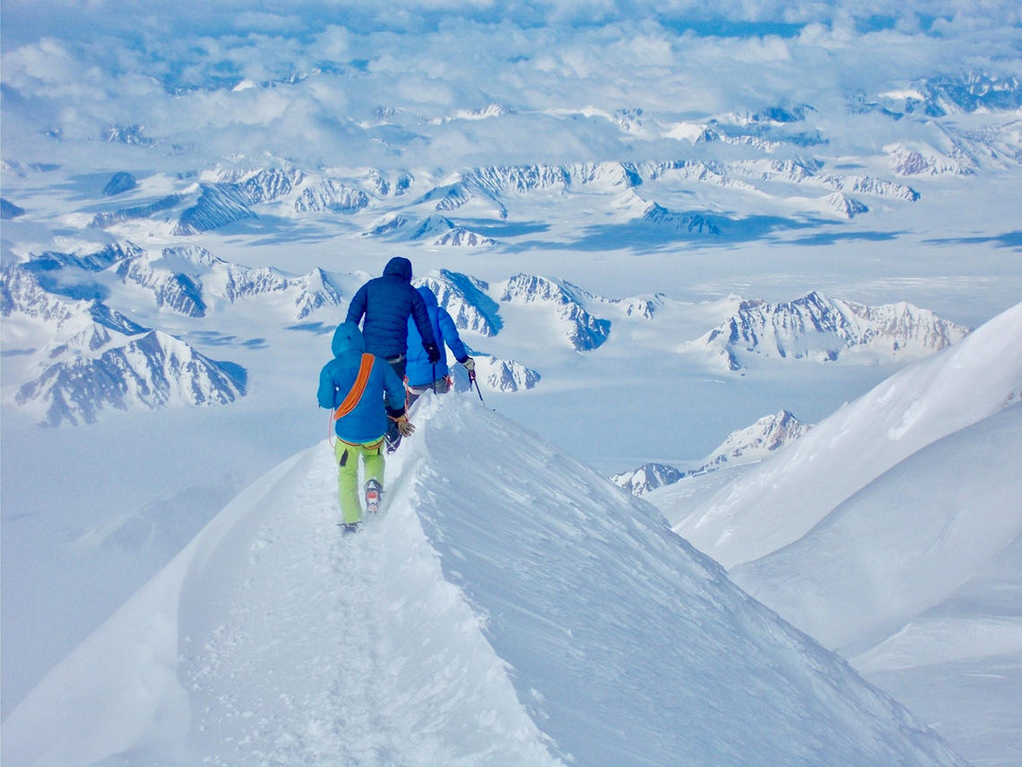 Paul Chiddle descending with two clients from the summit of Mt Logan, the highest peak in Canada.