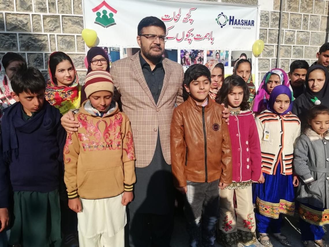 Professor Aamir Jamal with students in Abbottabad, Pakistan.