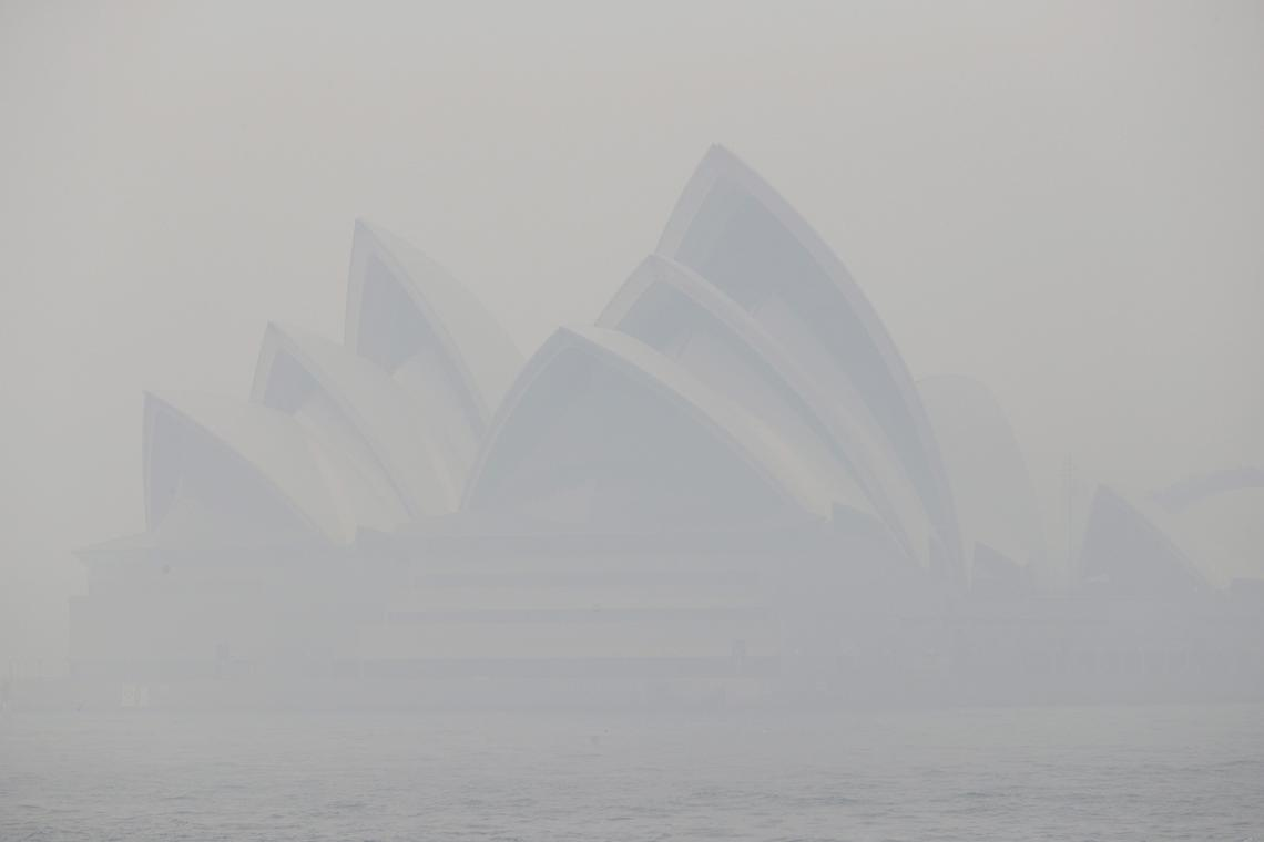 Thick smoke from bushfires blanked the Opera House in Sydney, Australia, on Dec. 10, 2019.