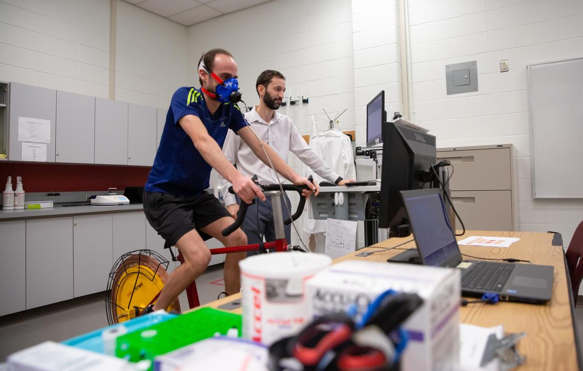 Associate professor Juan Murias monitors Danilo Iannetta during a workout.
