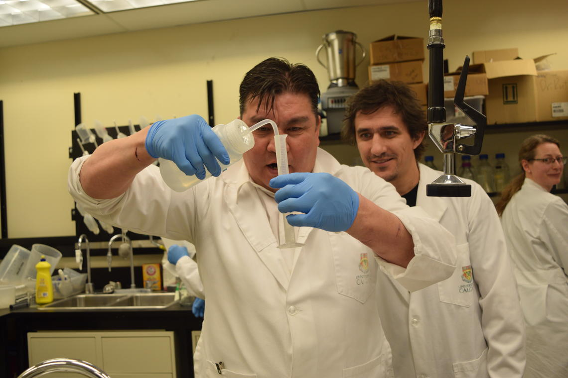 Two people in lab with test tube