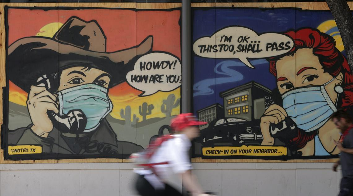 A mural painted on a boarded up business in Austin, Tex., reminds people to check on a neighbour during COVID-19 restrictions, April 27, 2020.
