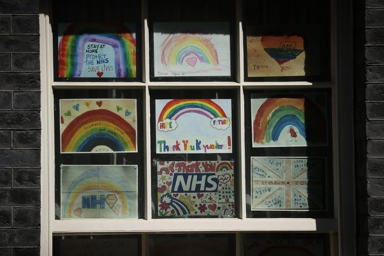 Art from children thanking the National Health Service are displayed in a window at 10 Downing Street in London, May 6, 2020