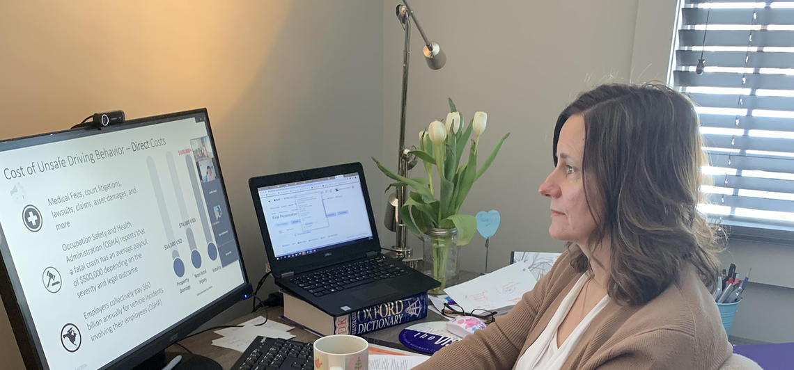 Instead of teaching in a classroom, Catherine Heggerud connects with students from her home office.