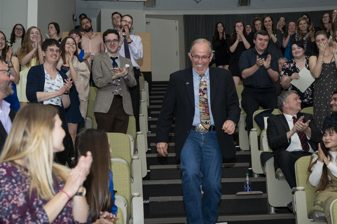 Gordon Atkins gets a standing ovation on winning the Carl J. Norden Distinguished Teaching Award in 2018.