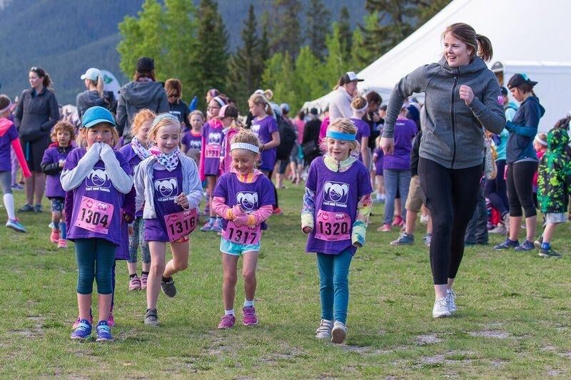 Kira Makuk plays warmup games with the girls as she volunteers for Fast and Female at the Rocky Mountain Soap Run in Canmore.