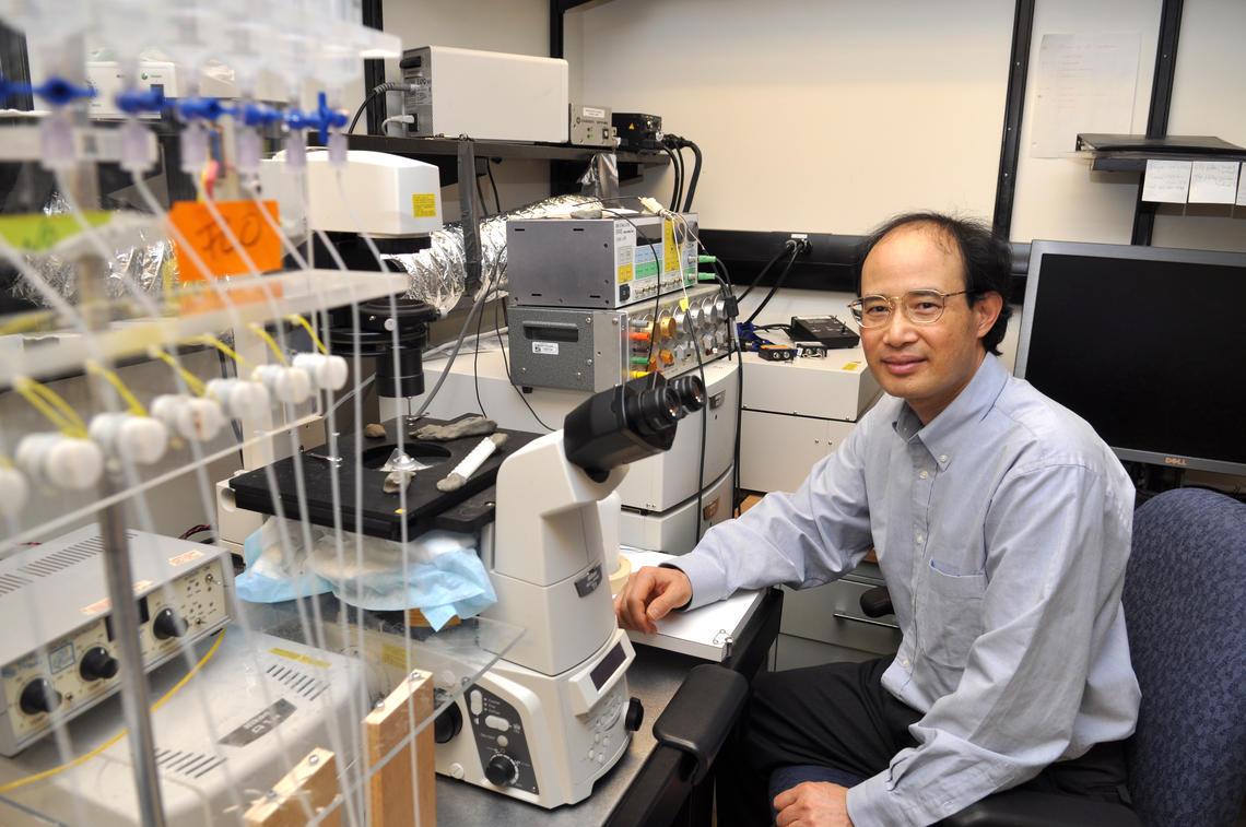 Dr. Wayne Chen, PhD, in his lab at the Cumming School of Medicine