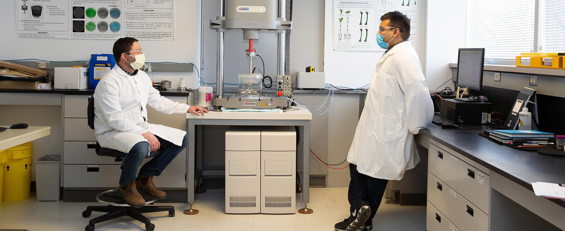 Brent Edwards, PhD (left) and Ifaz Haider, PhD, in the lab, Faculty of Kinesiology.
