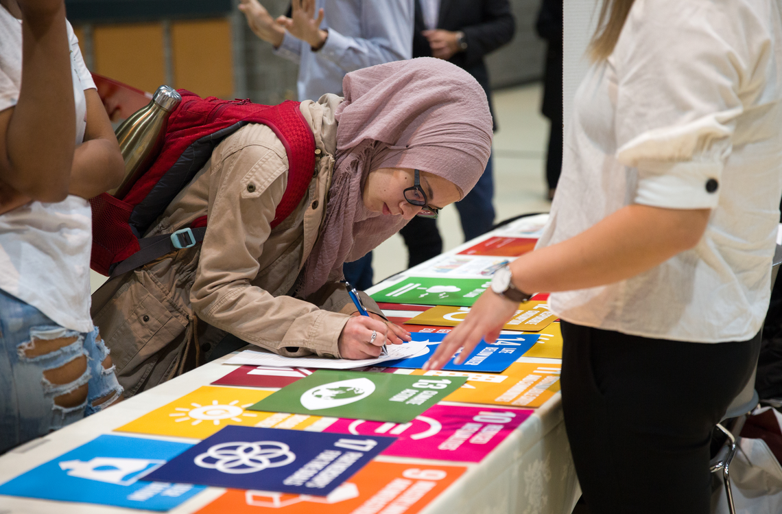 Students, faculty, guest speakers and staff take part at the 2018 Sustainability Report at UCalgary. Note: Photo was taken pre-COVID.