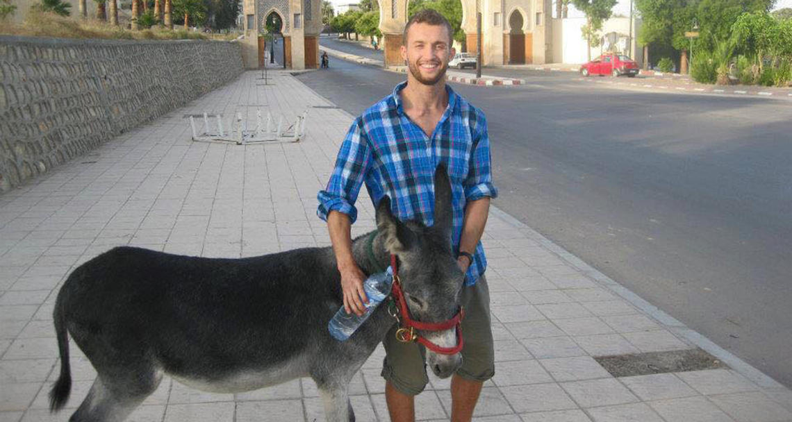 Mooshkeil the donkey and Scott Zaari became fast friends during his summer spent volunteering at the American Fondouk in Fes, Morocco.