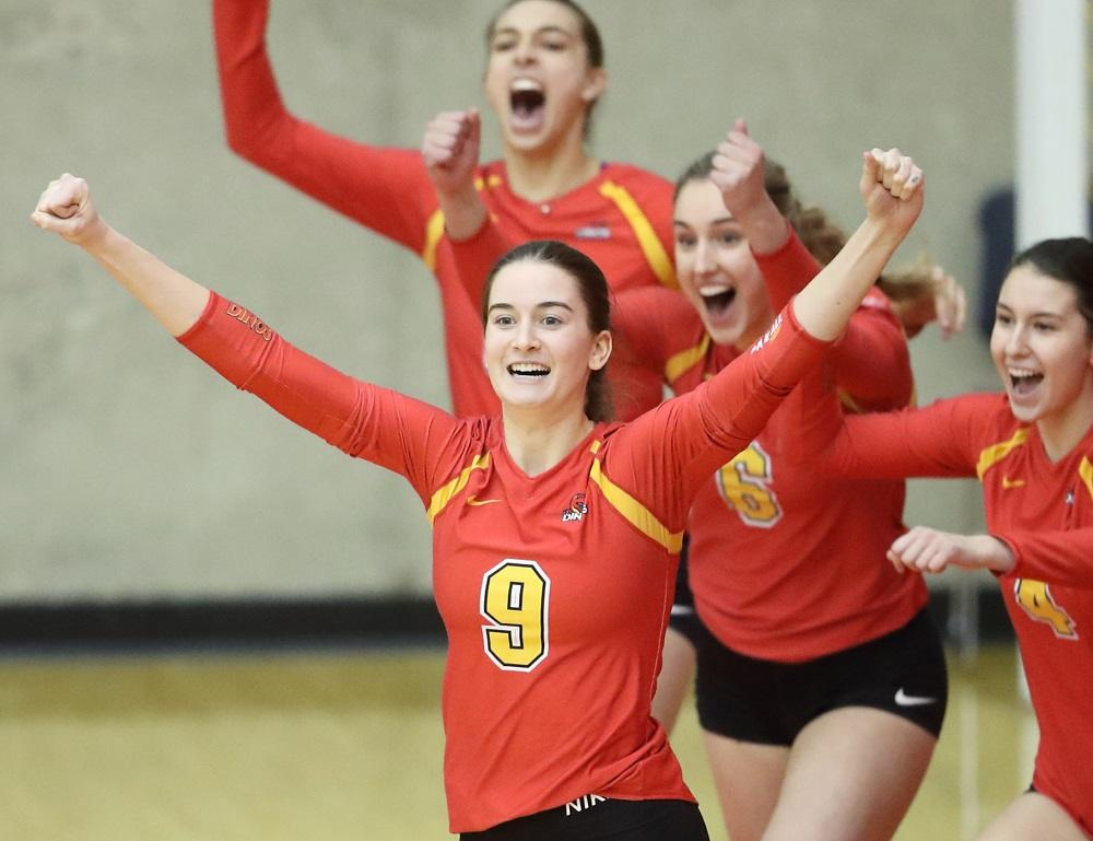 Lexi Peart, Kinesiology student and Dinos volleyball player at a game cheering (front) h program (MSc) in the UK at the prestigious University College London.