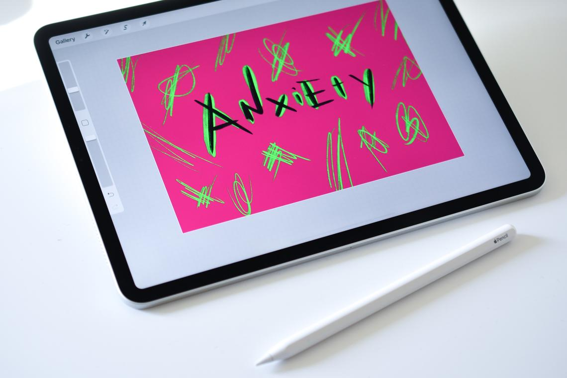 """Tablet with """"Anxiety"""" written on the screen in a colour design"""