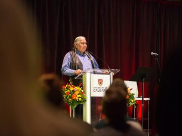 Reg Crowshoe, Piikuni elder and member of the University of Calgary Senate, gives blessings.