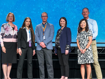 2nd Place - Creative Protein Solutions The team was presented with a $10,000 cheque at the 2019 TENET i2c competition finals. From left: Dr. Brenda Kenny, Daria Venkova and Jeroen De Buck, Sandra Stabel, Elisa Park, and Ken Moore.
