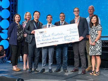 Fluid Biotech Inc. team receives 1st place and the prize cheque at the 2019 TENET i2c competition finals. From left: Sandra Stabel, Dr. Brenda Kenny, John H. Wong, Dr. Alim Mitha, Rahim Nathu, and Casey Smit, Elisa Park, and Ken Moore.