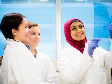 Dalia Abdelaziz, Eyes High Postdoctoral Fellow, works with Hailey Cox (left) and Tamia Duchesneau on a prion disease protein project