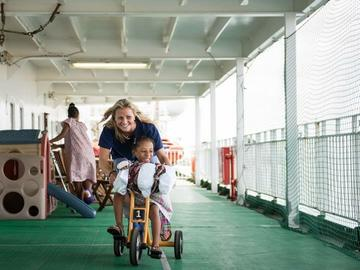 Tara McHardy plays with a patient on board