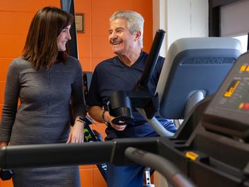 Nicole Culos-Reed, PhD with cancer and exercise program participant