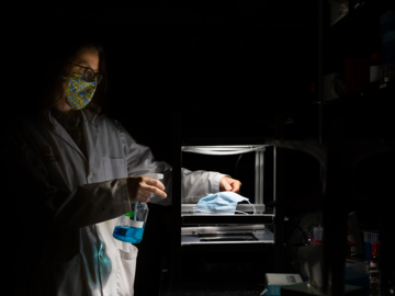 Dr. Heyne is in spotlight as she uses the light rig in her laboratory to activate the methylene blue solution
