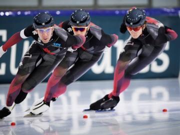 Ted-Jan Bloemen, Jordan Belchos, and Connor Howe compete in the Men's Team Pursuit at the ISU World Speed Skating Championships in Heerenveen, the Netherlands, Friday, Feb. 12, 2021.