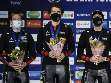 Ted-Jan Bloemen, Jordan Belchos, and Connor Howe celebrate their Silver medal on the podium of the Men's Team Pursuit at the ISU World Speed Skating Championships in Heerenveen, the Netherlands, Friday, Feb. 12, 2021.