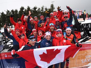 Tom Stephen (blue jacket and white headband first row, second from the right) celebrating medal win with the Canadian team at the World Juniors.