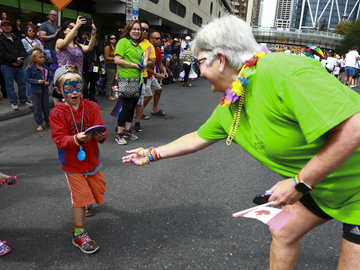 Dr. Dru Marshall showed off the UCalgary spirit while marching through the streets of downtown Calgary in 2017 at the Calgary Pride Parade.