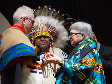 A pipe bag transfer ceremony with President Ed McCauley and Dr. Dru Marshall to mark the two-year anniversaryofii' taa'poh'to'p, UCalgary's Indigenous Strategy.