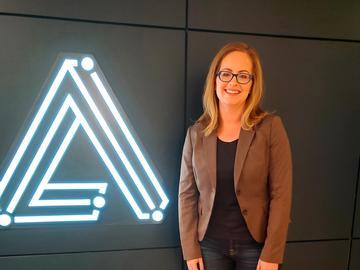 Nicole with Alta ML logo