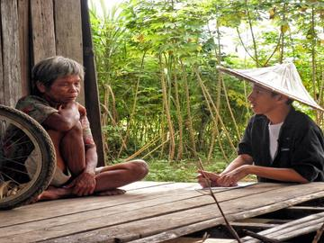 ADZU-SOM student speaking with a village elder.