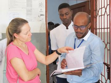 Dr. Brenner working with a colleague in Tanzania