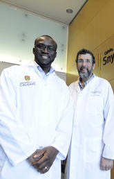 Henry Ogbomo, left, and Chris Mody have discovered that the body's army of natural killer cells have different ways to attack predators, like cancerous tumour cells and the microbes that cause infections. Photos by Pauline Zulueta, Cumming School of Medicine