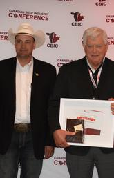The University of Calgary's Eugene Janzen is awarded the 2018 Canadian Beef Industry Award for Outstanding Research and Innovation. From left: Andrea Brocklebank, BCRC executive director; Ryan Beierbach, BCRC chair; Eugene Janzen; Bob Lowe, Bear Trap Feeders; and Reynold Bergen, BCRC science director.