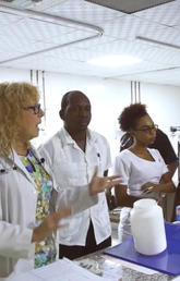 Karen Then, RN PhD, speaks with a group of nurses in training as part of the Guyana Program to Advance Cardiac Care. Photos courtesy Project 7 Media Group