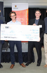 First-place team Neuraura was presented with the prize cheque at the 2018 TENET i2c competition finals on May 8. From left: Jon Meddings, dean of the Cumming School of Medicine; Pierre Wijdenes and Colin Dalton of Neuraura; and competition founder Ken Moore.