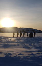 Huddled next to a frozen lake in the Northwest Territories, the Faculty of Science-led team from the University of Calgary conducts experiments in the spring of 2018.