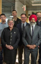 Celebrating the Calgary Firefighters Burn Treatment Society's $1 million renewal of its Chair in Skin Regeneration and Wound Healing, held by Jeff Biernaskie, are, from left: Tara Walmsley, Thomas Kerr, Dru Marshall,  Trevor Huggins, Duncan Nickerson, Baljit Singh, Vincent Gabriel, Jeff Biernaskie, Todd Nabozniak, and Rod Griffith. Photo by Colleen De Neve, for the University of Calgary